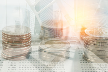 Double exposure coins and modern city background, Finance and banking concept