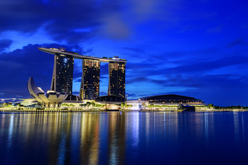 Wall Mural - Cityscape of Singapore skyline at twilight time. Marina Bay is a