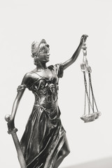 Black and white image of Lady Justice, statuette of the Themis goddess. Law concept.
