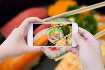 sushi maki in chopsticks
