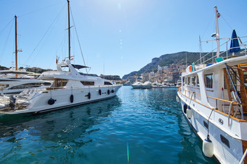 Monaco, Monte-Carlo, Monaco Ville, 8 August 2016: Port Hercules, the preparation of the yacht show MYS, sunny day, many yachts and boats, RIVA, Prince's Palace of Monaco, megayachts, Massif of houses