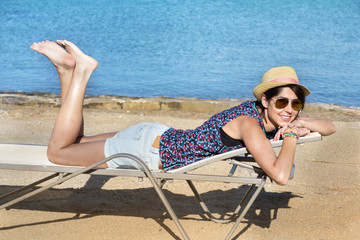 beautiful fashion  woman with straw hat relaxing on the beach.Summer holiday concept