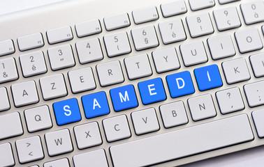 SAMEDI writing on white keyboard