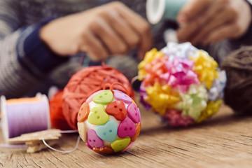 man making handmade christmas balls