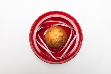 delicious donut and muffins with tape-measure on plate, on white backgrounds, diet concept