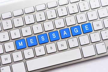MESSAGE writing on white keyboard