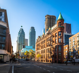 Wall Murals Toronto Gooderham or Flatiron Building in downtown Toronto with CN Tower on background - Toronto, Ontario, Canada