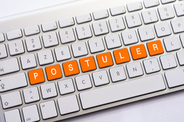 POSTULER writing on white keyboard