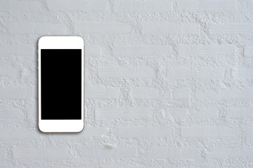 Top view smartphone mock up template with black screen on cement table with copyspace.