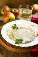Pork, cooked with white wine and sauerkraut