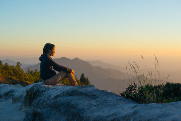 Women see sunset light and mountains view