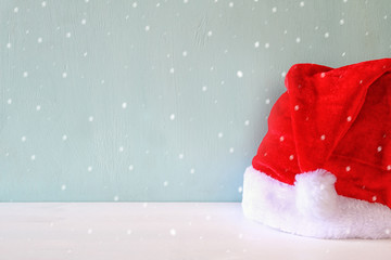 Santa claus red hat on wooden table