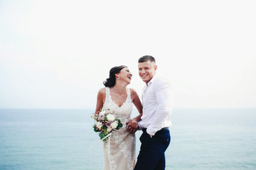 Newlyweds and sea