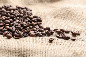 Wall Murals Coffee beans Brown roasted coffee beans on sackcloth