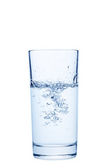 Water pouring in glass isolated on a white