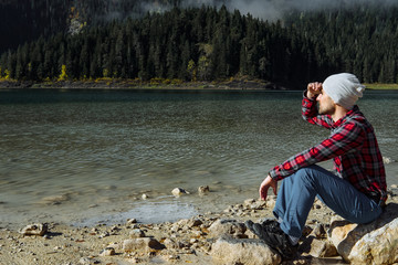 Hipster traveler enjoying view of Black Lake, Durmitor National