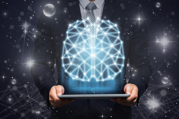 Businessman holding the tablet showing the brain over the Innova