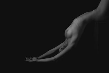Art photo of beautiful nude woman over dark background