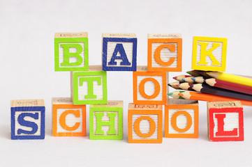 Back to school spelled with alphabet blocks