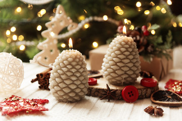 New Year festive candles on the wooden table