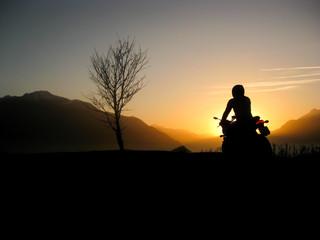 Sunset motorbike rider