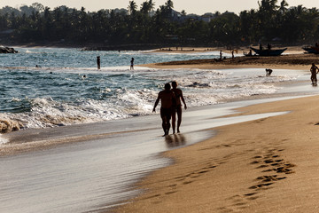 couple walking evening beach
