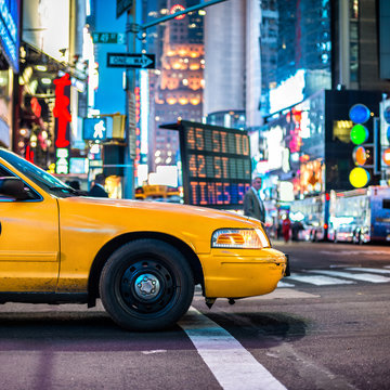 Yellow cab taxi in Manhattan, NYC. The taxicabs of New York City at night Time Square..