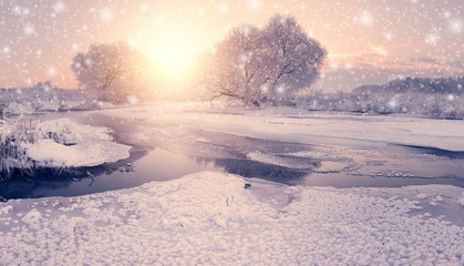 Snowfall in winter morning. Colorful Christmas background.