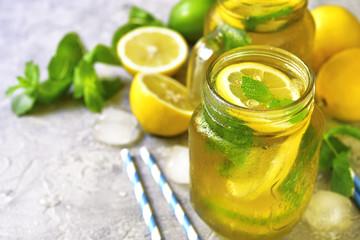 Homemade sparkling lemonade on a grey concrete,stone or slate ba