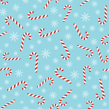 Christmas seamless blue pattern with candy canes