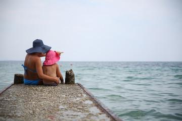 Woman in blue bikini enjoying beach and summer sunny day