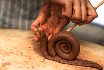 Master shows how to sculpt clay snail