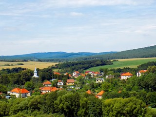 Small village in nature between forests and fields in Slovakia, countryside landscape
