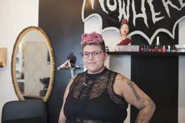 Portrait of beautician standing in salon