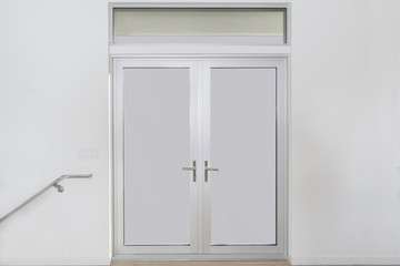 Aluminum door with double glass window and copy space for your background.
