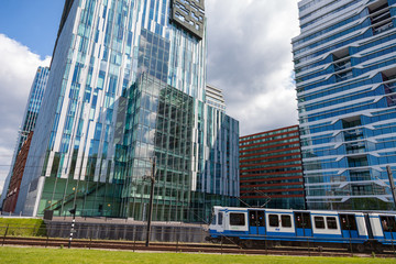 Tram at offices on the Zuid-as in Amsterdam Holland