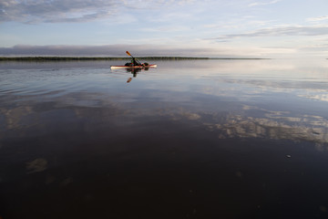 A woman paddles her kayak on the Amur river in far East Russia.