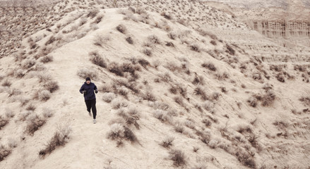 trail runner in red rock canyon near mojave ca.