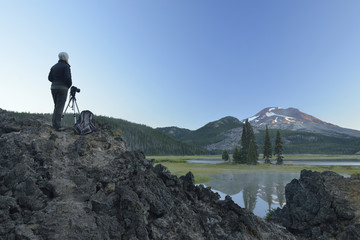 Girl taking photos with Canon Camera at Sparks Lake, Central Oregon, USA