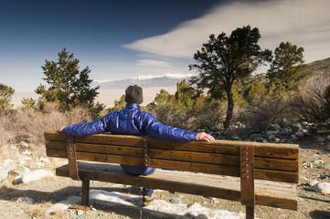 A man sitting on bench alond the trail to Zapata Falls, Bureau of Land Management Land,Alamosa, Colorado.