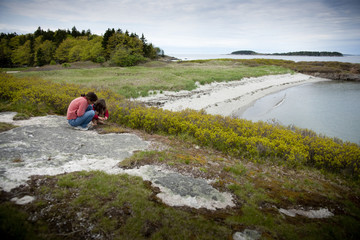 Children play along the coast at Hermit Island Campground in Phippsburg, Maine.