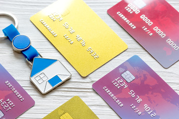 credit cards, key ring - concept mortgage on wooden background