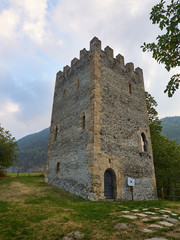 """Oulx, Italy _ October  03, 2016 Medieval square crenellated tower called """"Delfinale"""" or """"Saracena"""" ."""