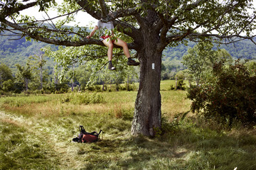 A hiker takes a hiking break in a tree over the Appalachian Trail