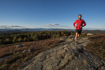 trail runner high in the mountains.