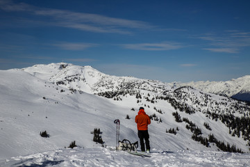 Skiers in the backcountry while completing the Spearhead Traverse near Whistler, British Columbia, Canada.