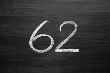 number sixty two enumeration written with a chalk on the blackboard