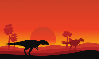 Silhouette of mapusaurus orange sky scenery