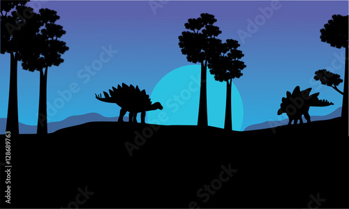 Silhouette of stegosaurus blue sky scenery