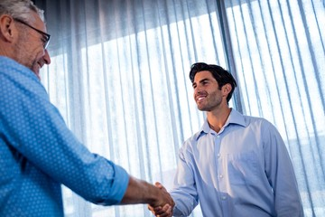 Two businessmen giving a handshake